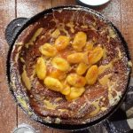 spiced chocolate dutch baby pancake with caramelised bananas and peanut butter