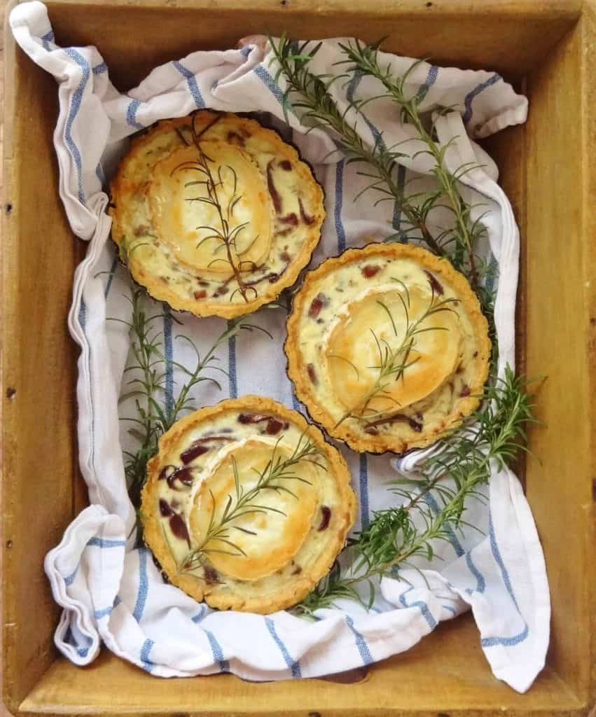 Caramelised red onion and goats cheese tarts - crisp parmesan pastry filled with balsamic caramelised red onions, egg custard and goats cheese.