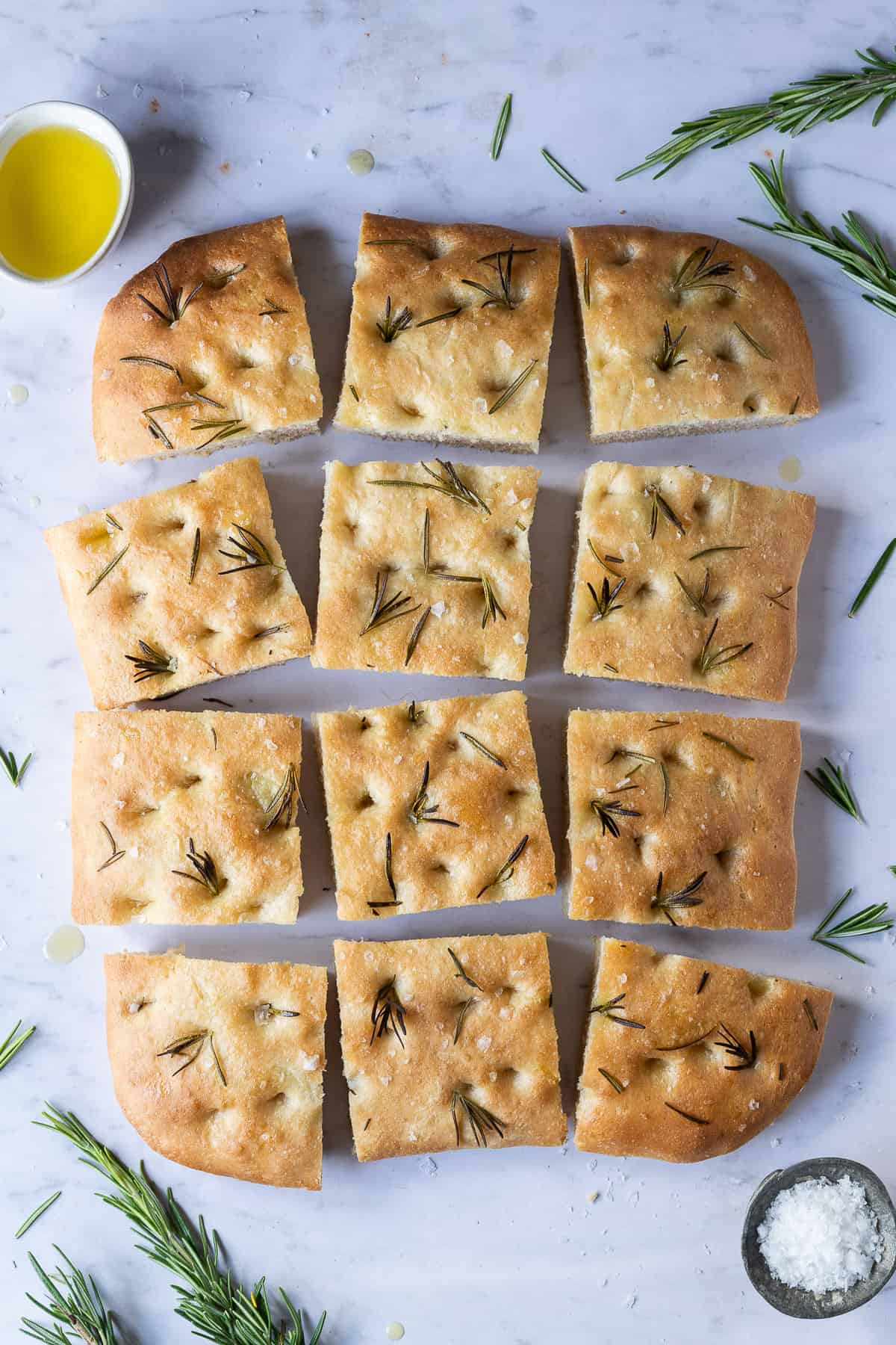 squares of focaccia on a marble background