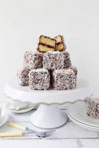Jam lamingtons - squares of vanilla sponge cake filled with cherry jam, coated in chocolate and coconut - Domestic Gothess