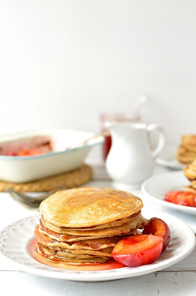Honey and cinnamon cornmeal pancakes with lemon honey cinnamon syrup and roasted plums - Domestic Gothess