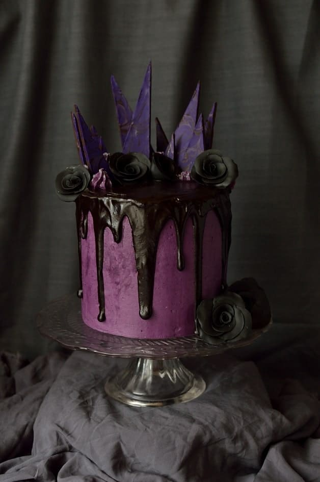 Chocolate blackberry elegantly gothic Halloween cake with blackberry swiss meringue buttercream and backberry ganache