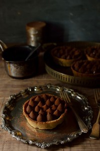 Chocolate, salted caramel and hazelnut tarts
