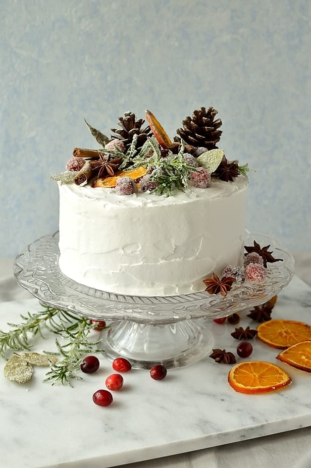 moist gingery christmas fruitcake topped with marzipan royal icing and rustic decorations of sugared