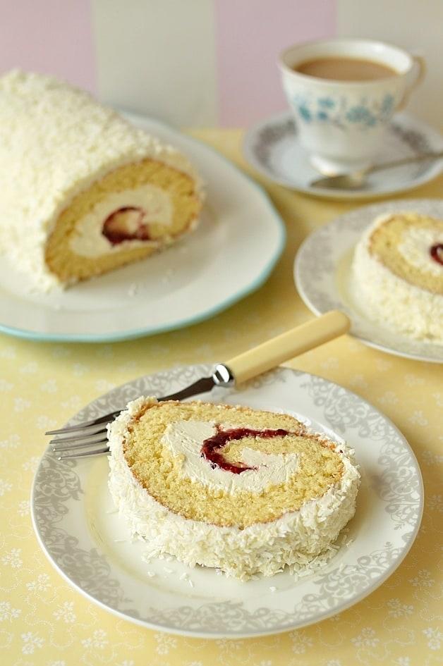 Coconut & cherry swiss roll cake - whisked sponge filled with cherry jam & light, fluffy coconut swiss meringue buttercream, perfect for Easter