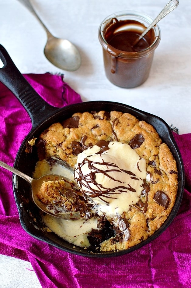 Mini nutella stuffed chocolate chunk skillet cookie for two - the perfect indulgent Valentines day dessert.