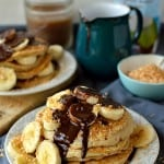 Toasted coconut pancakes with coconut milk chocolate fudge sauce and banana, a delicious, decadent breakfast or brunch (dairy-free)