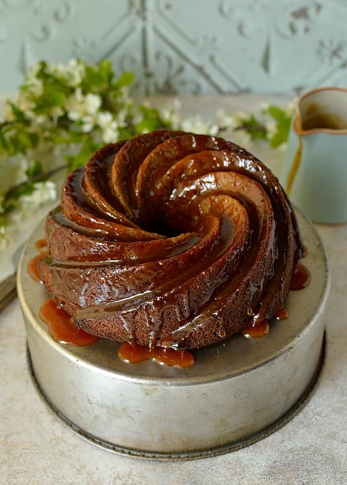 Banana rum caramel bundt cake, moist banana cake with a hint of rum & nutmeg with banana rum caramel sauce