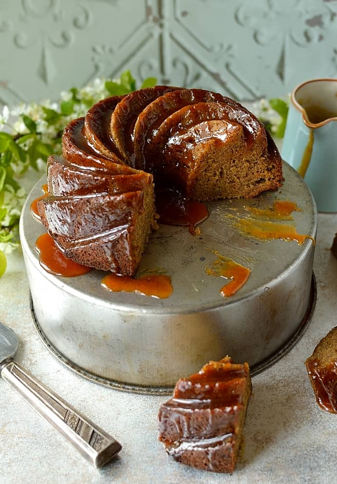 Lightly spiced banana bundt cake with banana rum caramel sauce