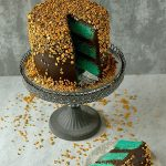 Layers of velvety vanilla cake with fudgy chocolate buttercream and a cascade of gold sprinkles