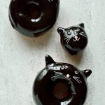 Chocolate glazed fried doughnuts with a cute (and easy) black cat design, a perfect treat for Halloween!