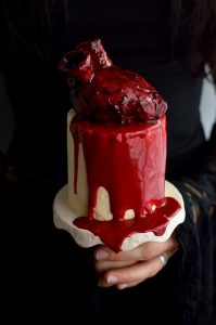 Mini red velvet layer cakes with cooked flour frosting, bloody heart cakes and gananche 'blood'; ideal for Halloween