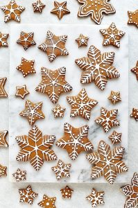 Royal icing topped gingerbread star and snowflake biscuits