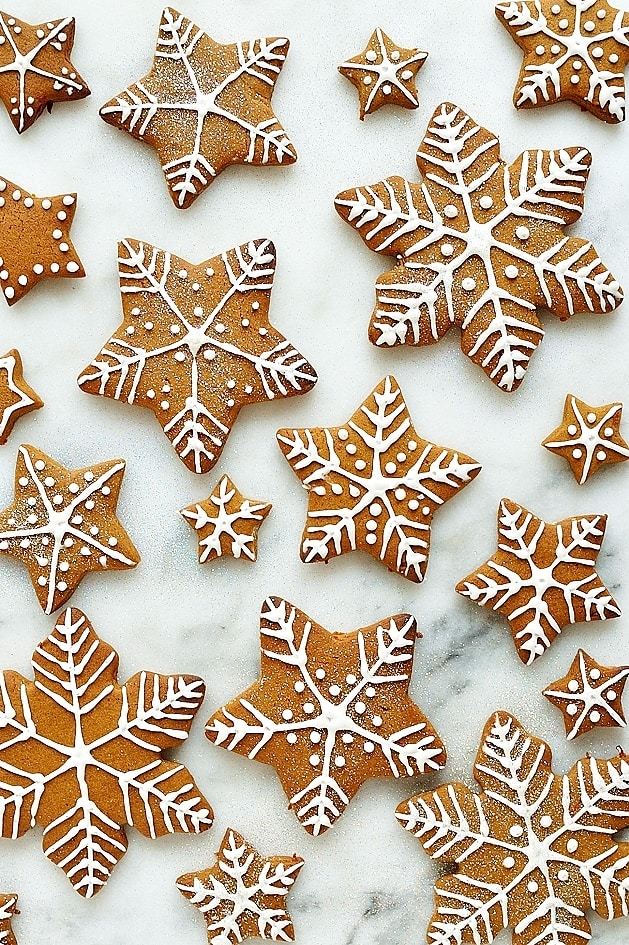 Gingerbread star and snowflake cookies with royal icing designs