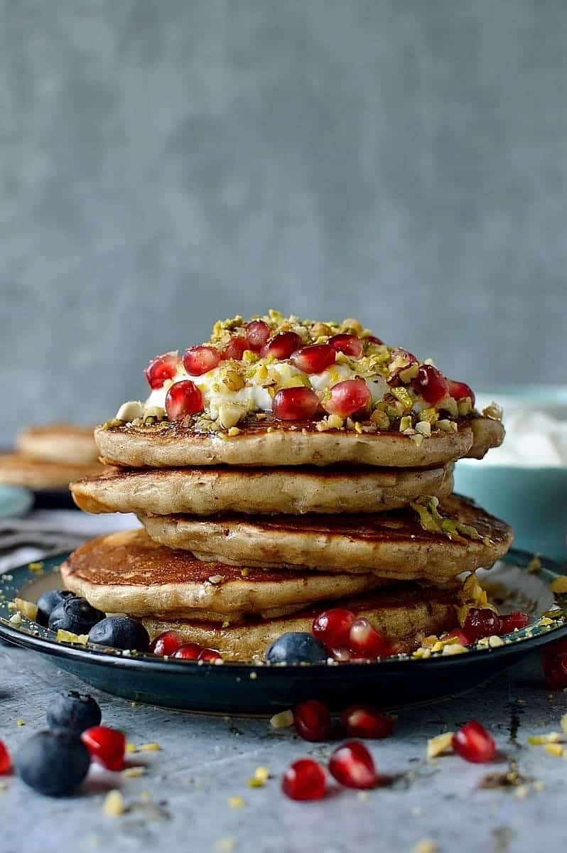 Baklava pancakes - soft, fluffy Greek yoghurt pancakes flavoured with cardamom, cinnamon and chopped pistachios, walnuts and almonds topped with a delicious honey, orange blossom, lemon and rose syrup.