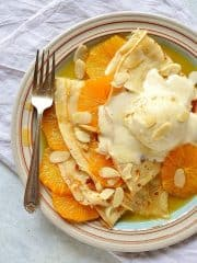 Pancakes (crepes) with caramel oranges and almond ice cream - an indulgent dessert or brunch!