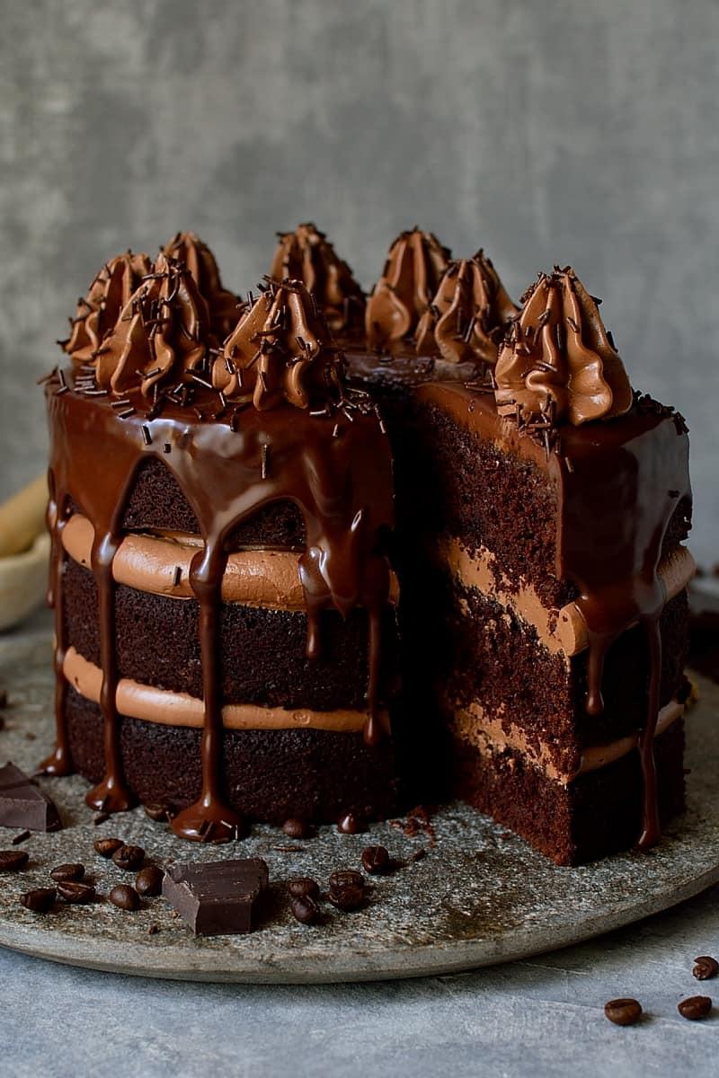 Chocolate coffee cardamom layer cake - three layers of moist chocolate coffee cardamom cake with swiss meringue buttercream and dark chocolate ganache.