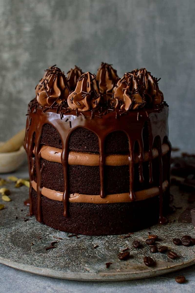Chocolate coffee cardamom layer cake - three layers of moist chocolate coffee cardamom cake with swiss meringue buttercream and dark chocolate ganache.
