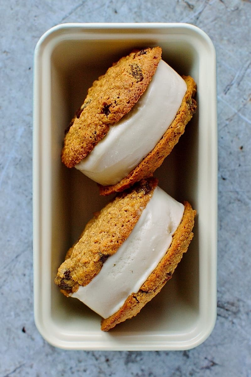 Manuka honey coconut ice cream sandwiches - rich, creamy, dairy-free manuka honey and coconut ice cream sanwiched between dairy-free honey oatmeal raisin cookies.