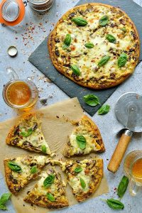 Mushroom pesto pizza - easy home made vegetarian pizza topped with garlic mushrooms, basil pesto and plenty of mozzarella and cheddar cheese.