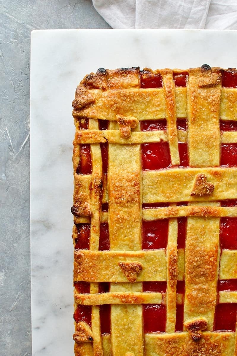Rhubarb orange almond pie - crisp orange pastry filled with almond and orange frangipane and tart rhubarb compote, topped with a pretty lattice design.