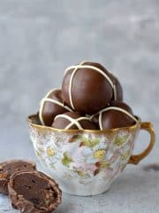 Hot cross bun chocolate truffles - rich, decadent chocolate ganache truffles flavoured with spices and mixed dried fruit, topped with a white chocolate cross.