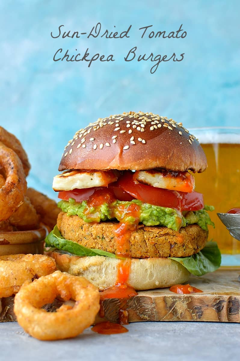 Sun-dried tomato chickpea burgers and beer battered onion rings - delicious vegetarian/vegan burgers served with the most amazing onion rings!