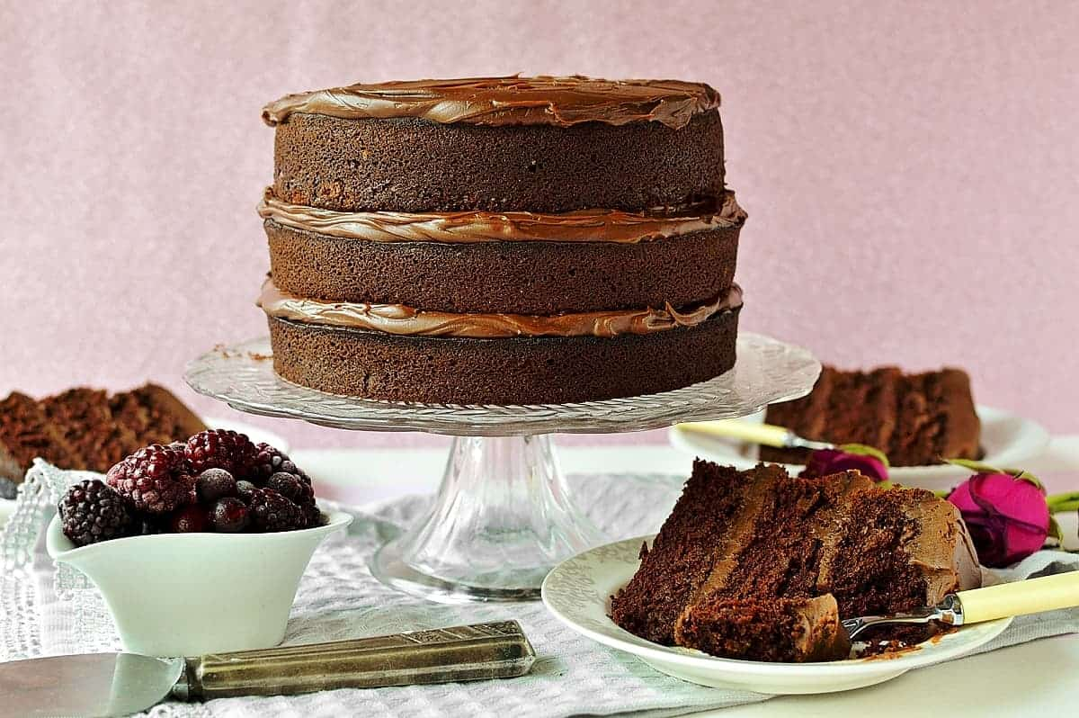 The best chocolate layer cake - three layers of moist chocolate cake filled with smooth chocolate ganache, perfect for any celebration!