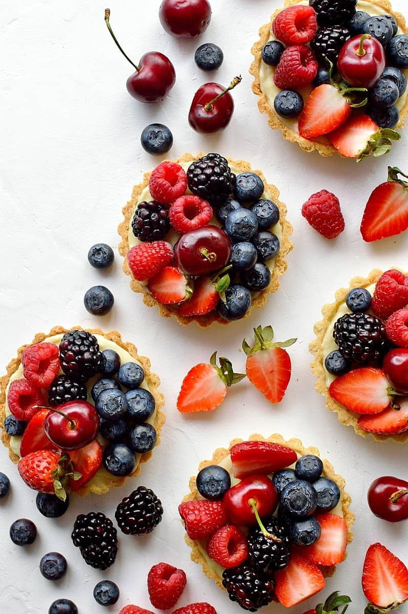 Coconut and berry fruit tarts - crisp coconut pastry with coconut pastry cream and fresh berries.