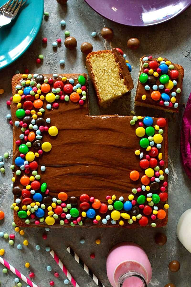 Yellow vanilla cake with chocolate ganache frosting - moist, tender yellow vanilla sheet cake with whipped chocolate ganache and M&M's.