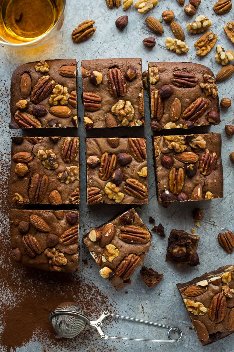 Nutty bourbon brownies – gooey, fudgy brownies with a boozy kick and plenty of crunchy nuts.