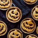 Halloween Jack-O-Lantern pumpkin pies - creepy (or cute - your choice!) pumpkin pies for Halloween.