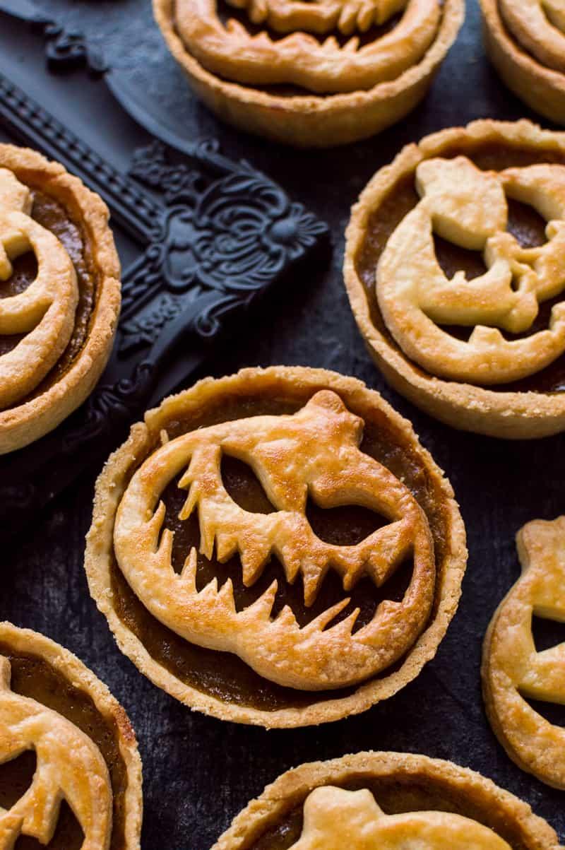 Mini Jack-O-Lantern pumpkin pies for Halloween.