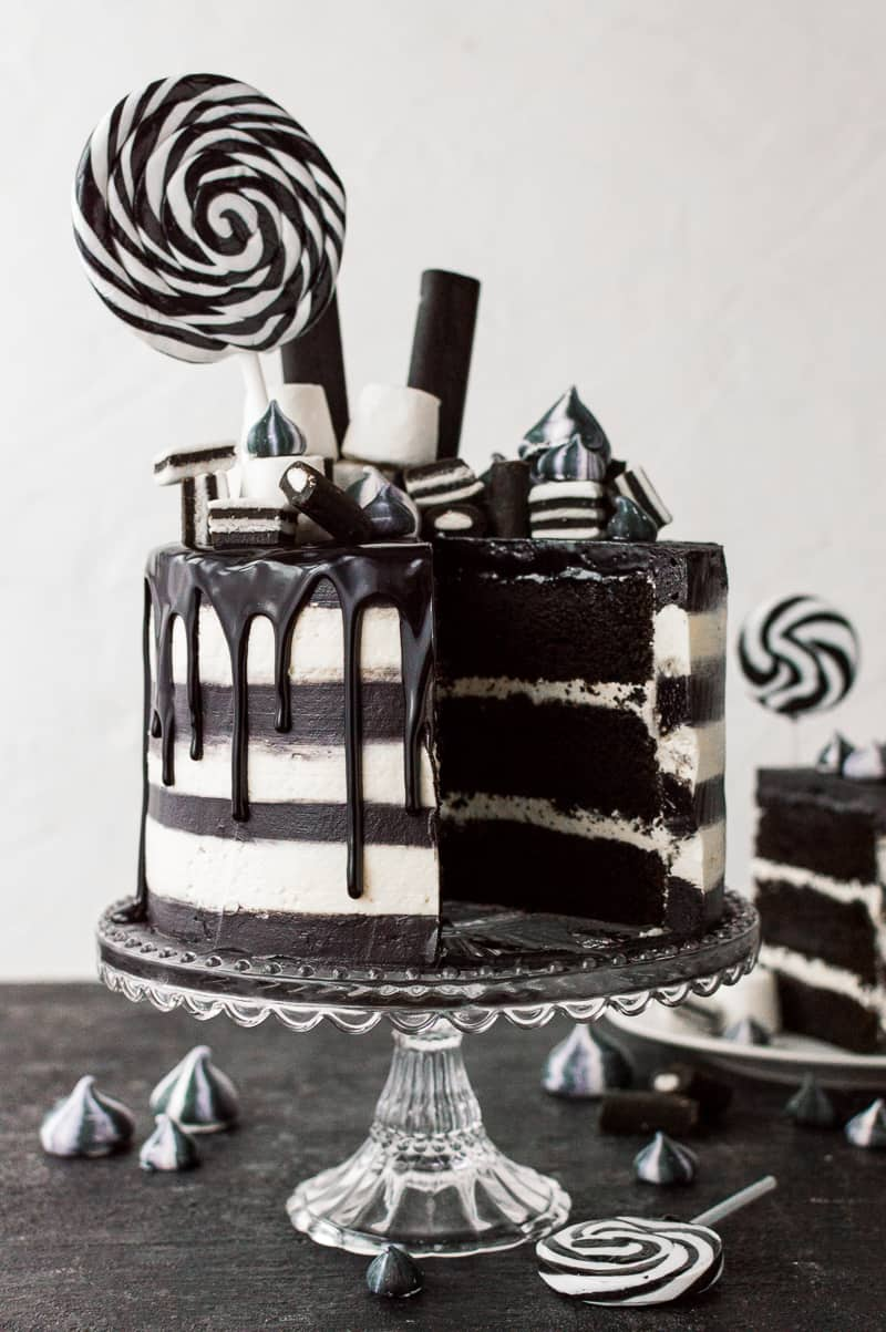 Black and white stripy Halloween cake with black and white meringue kisses.