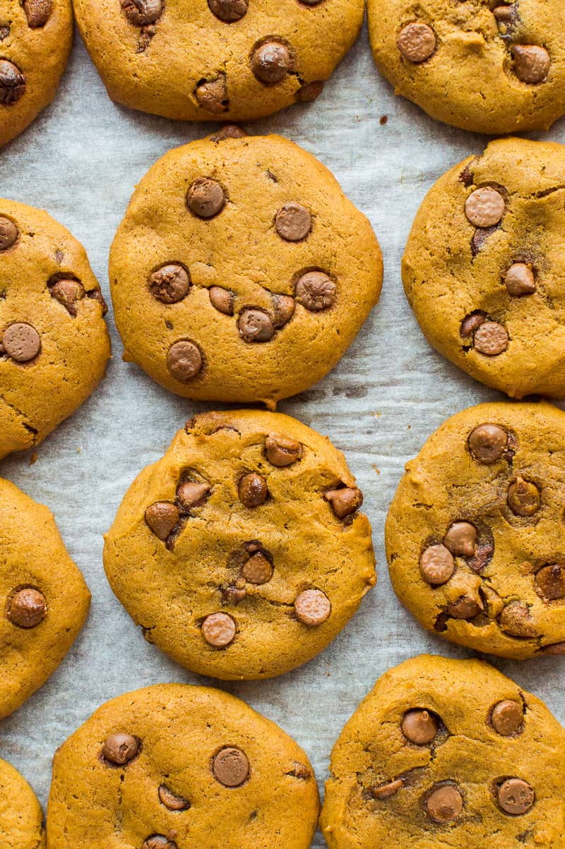 from above shot of easy, chewy vegan pumpkin chocolate chip cookies on a baking tray.