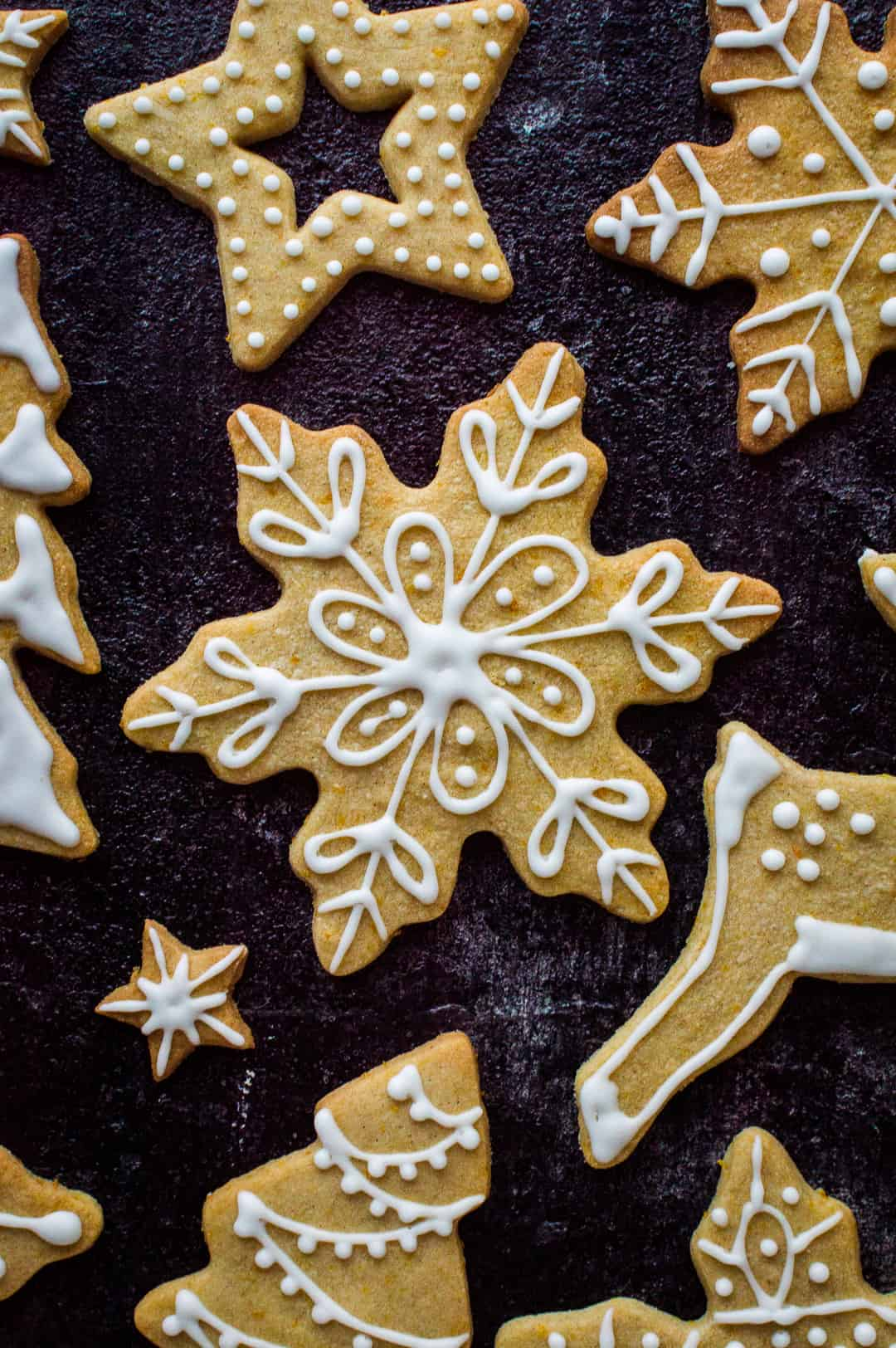 Orange cinnamon butter biscuit snowflake cookie with royal icing design