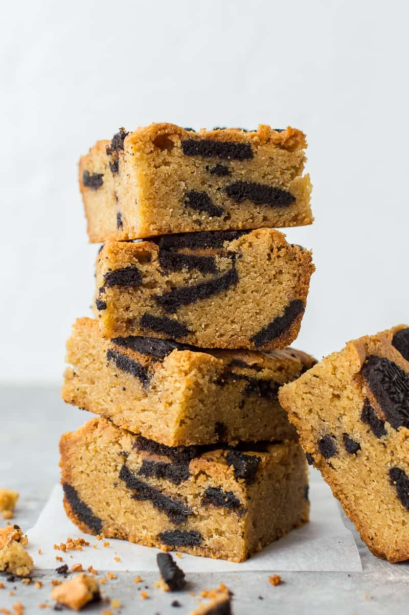 Side shot of a stack of peanut butter Oreo blondies.