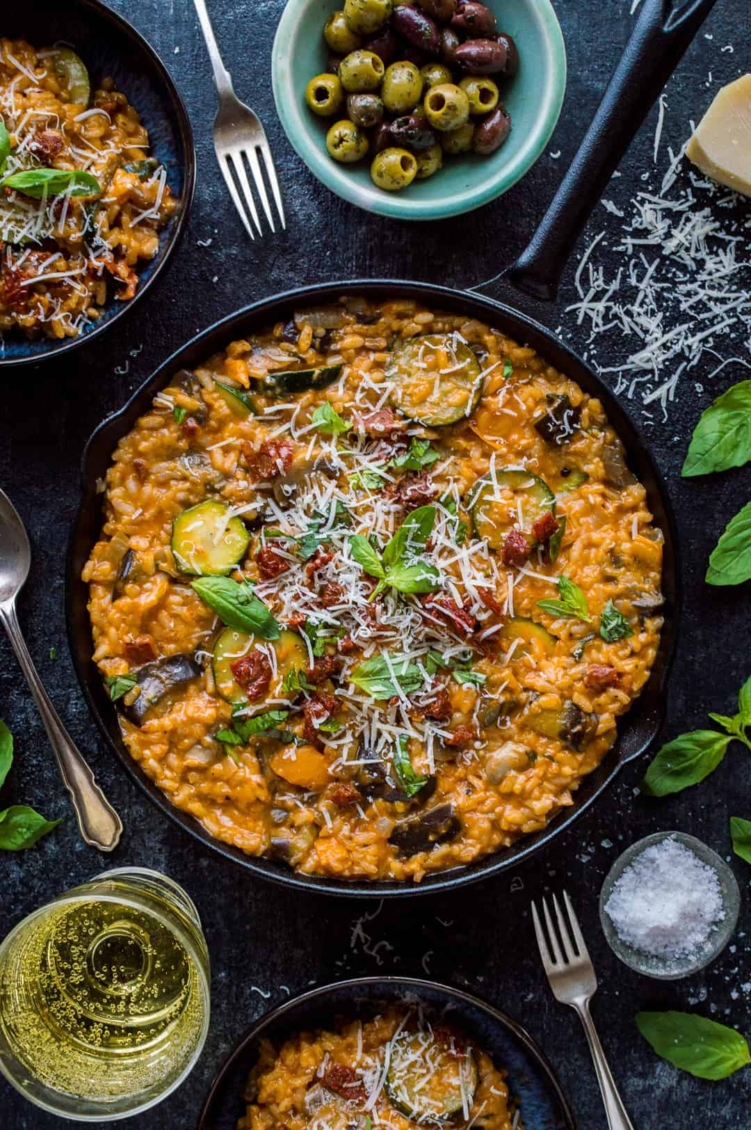 Ratatouille risotto - a creamy, flavourful vegetarian risotto filled with ratatouille vegetables, herbs, sundried tomatoes and veggie parmesan.
