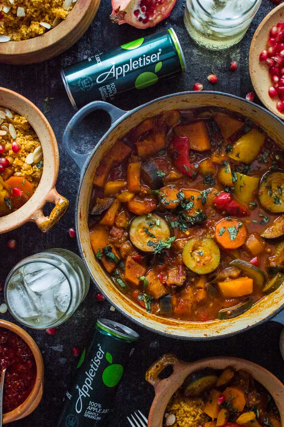 From above photograph of vegetable tagine with almond and chickpea couscous and Appletiser