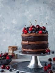 Vegan chocolate fudge cake - an easy to make, moist, fudgy vegan chocolate cake topped with coconut milk ganache. No one will be able to guess that it's vegan!