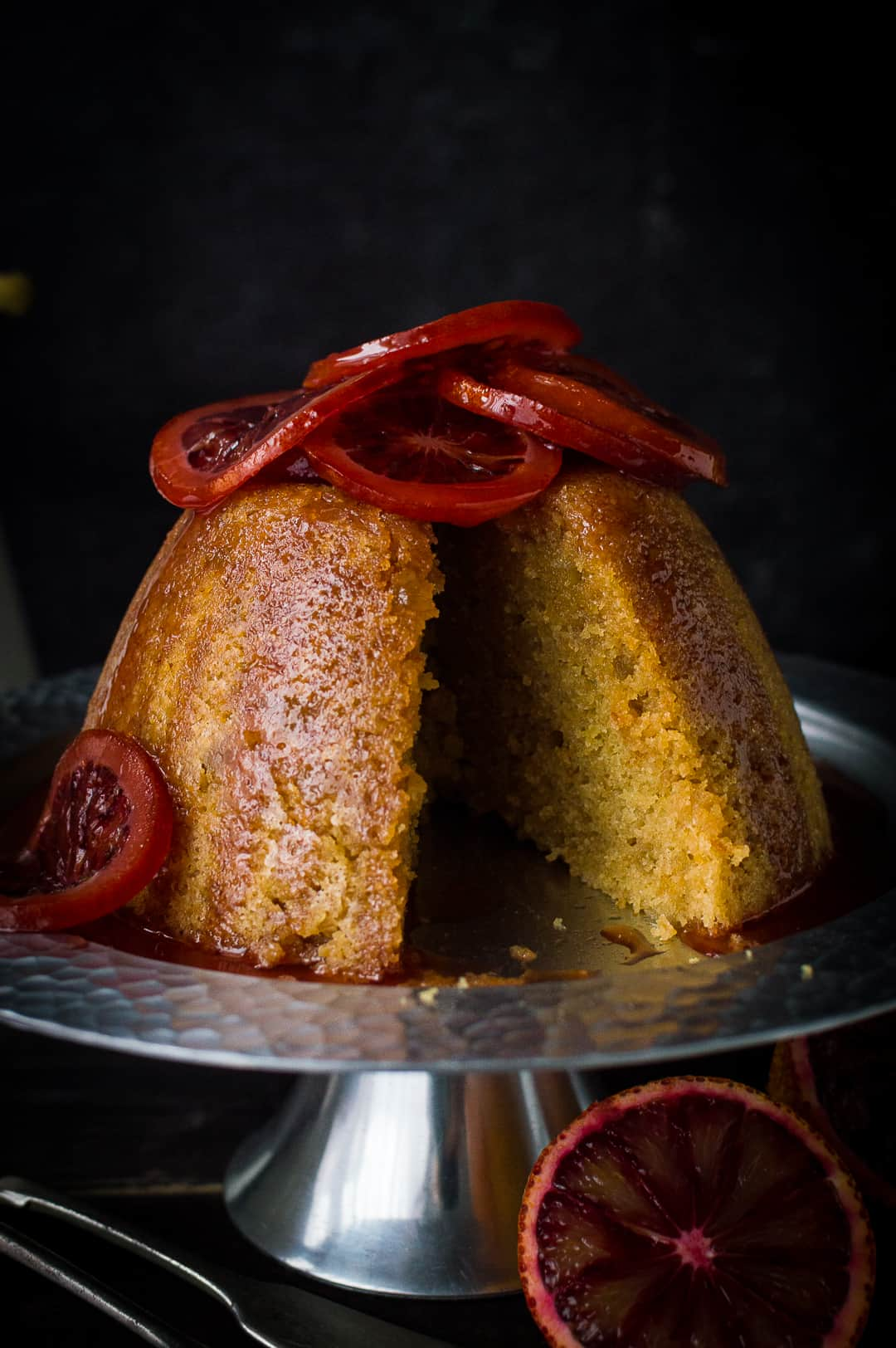 Close-up of sliced slow cooker blood orange and ginger steamed pudding.