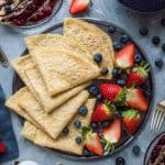 Vegan crepes with berry compote and chocolate sauce - easy, tender, egg and dairy free pancakes with a delectable chocolate sauce and mixed berry compote. Perfect for pancake day!