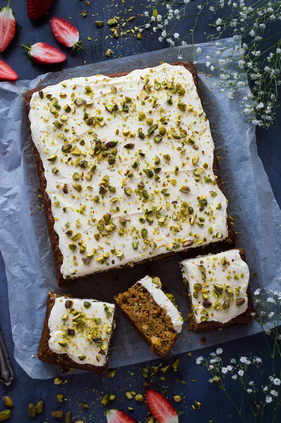 Carrot pineapple and pistachio sheet cake with cream cheese frosting.