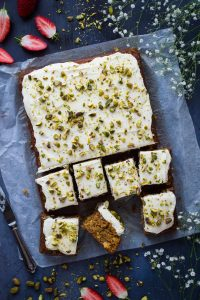 Carrot, pineapple and pistachio cake - a delicious tropical twist on carrot cake topped with a luscious cloud of cream cheese frosting.