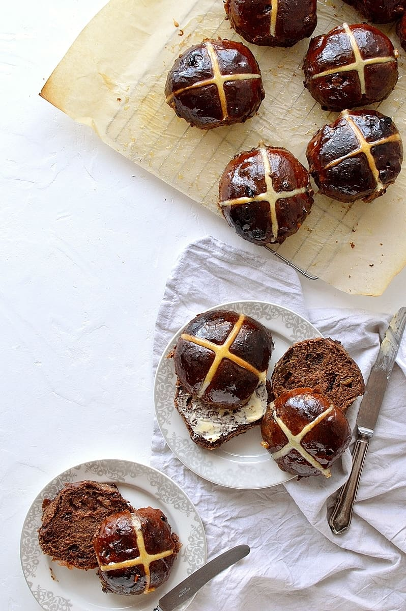 Easter chocolate orange hot cross buns on a white background