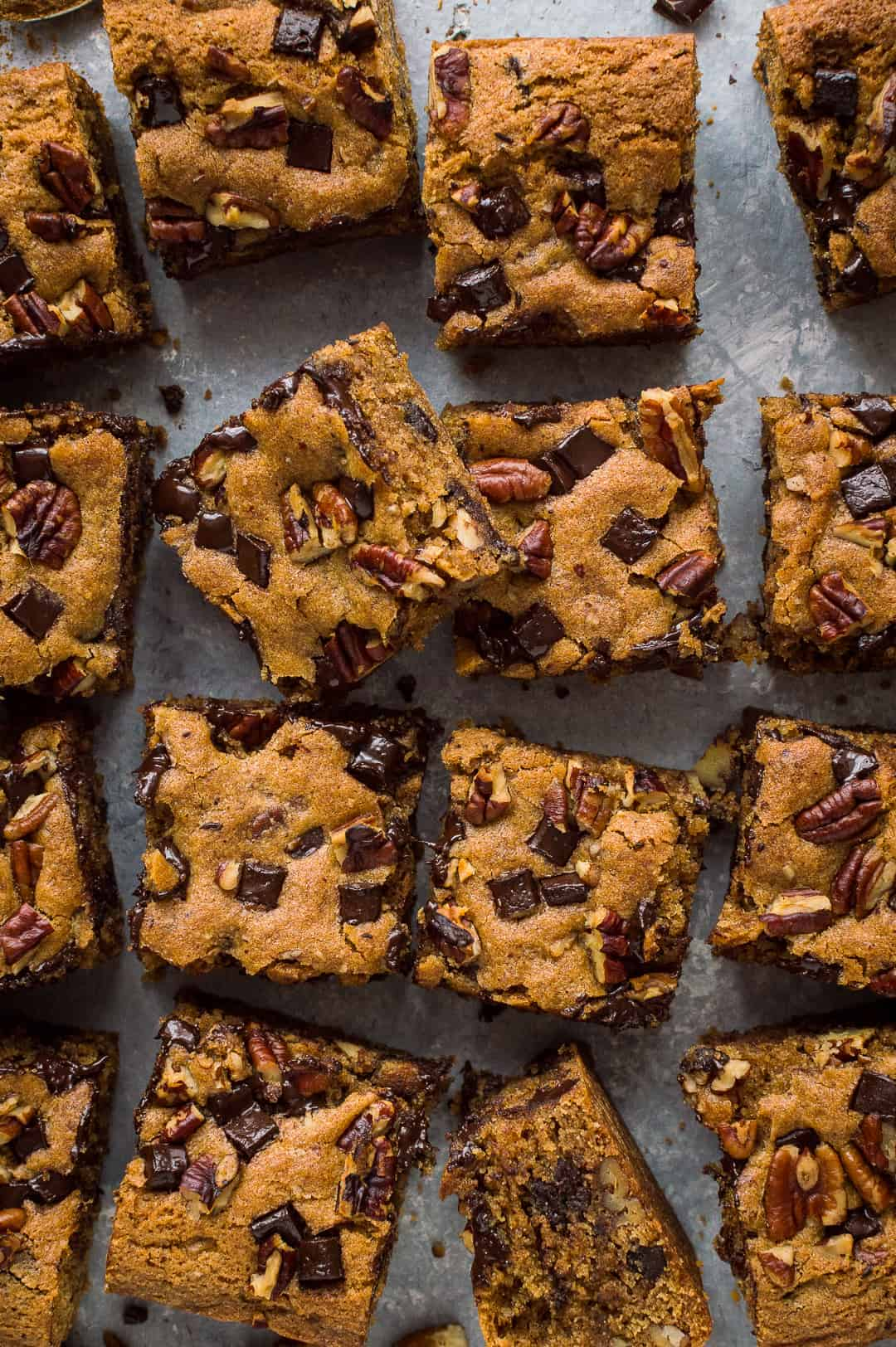 Top down photo of vegan peanut butter chocolate chip pecan bars sliced into squares.