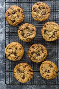 Vegan chocolate chip cookies - crispy round the edges, chewy in the middle, loaded with chocolate chips and really easy to make; these cookies will become your new favourite recipe!