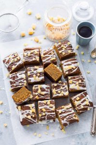 Vegan ginger cake - a moist, sticky, spicy sheet cake that is full of flavour, easy to make and perfect for snacking on. Egg and dairy free.