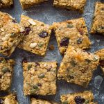 Vegan fruit and nut flapjacks - easy vegan oaty flapjacks (oat cookie bars) filled with dried fruits, nuts and seeds. Perfect for snacking, lunchboxes and hiking!