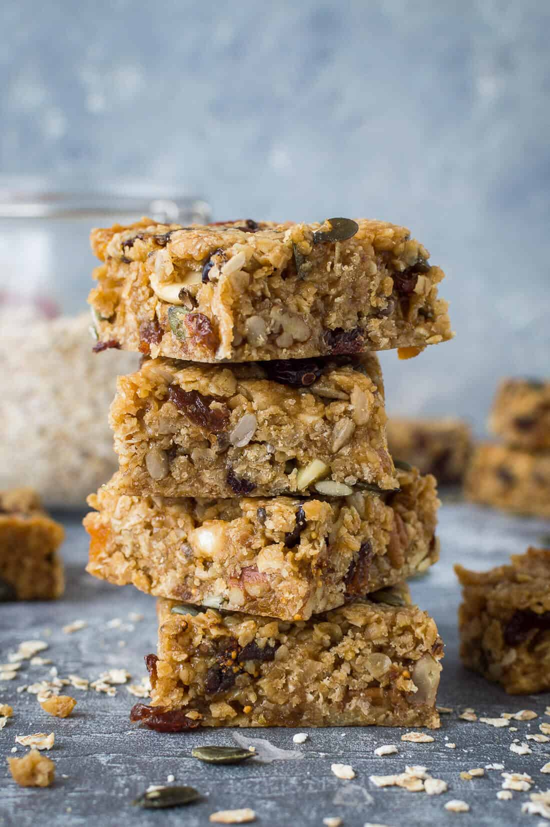 A stack of vegan fruit and nut flapjacks filled with dried fruits, nuts and seeds.